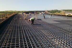 Роботы кипят: как проходит строительство запорожских мостов (фото) фото 2